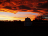 Click to see an image of Niteskys Observatory at sunset.